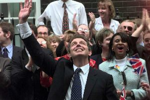 Tony Blair waves to wellwishers in  Downing Street following his election victory in 1997. Picture: AP