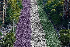 Edinburgh city centre will turn green, purple and white on 10 June to celebrate the 100th anniversary of votes for women