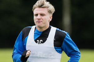 Jason Cummings will line up against old club Hibs for Rangers on Sunday