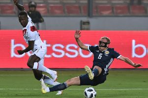 Dylan McGeouch challenges Luis Advincula for the ball. Picture: Cris Bouroncle/AFP/Getty