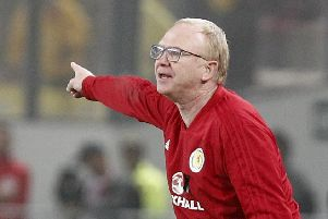 Alex McLeish issues instructions in the game against Peru