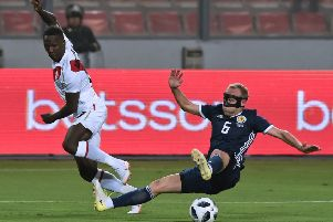 Dylan McGeouch won his first cap for Scotland against Peru last week. Picture: AFP/Getty.