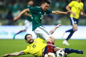 Hirving Lozano of Mexico struggles for the ball with Charles Mulgrew of Scotland during the International Friendly match between Mexico v Scotland at Estadio Azteca. Picture; Getty