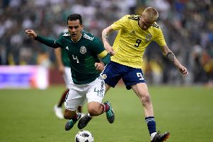 Mexico's Rafael Marquez and Scotland's Oliver McBurnie vie for the ball during their international friendly football match at the Azteca stadium. Picture; Getty