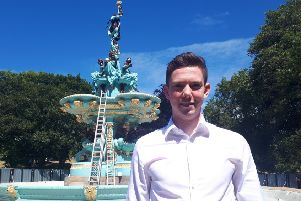 David Ellis stands in front of the revamped Ross Fountain, which his firm, the Ross Development Trust, has overhauled