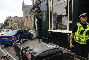 The car ploughed into the outside seating area for the Cask & Barrel pub in Broughton Street. Picture: TSPL