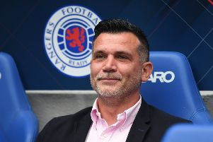Osijek manager Zoran Zekic sits in the dugout at Ibrox. Picture: SNS