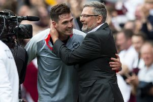 Kyle Lafferty with manager Craig Levein after the striker's goal was enough to defeat Celtic at Tynecastle. Picture: SNS