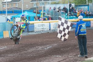 Monarchs No.1 Richie Worrall takes the chequred flag after being unbeaten all night. Pictures: Ron MacNeill