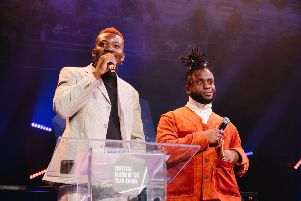 Alloysious Massaquoi, left, and Kayus Bankole collect the 2018 SAY Award at Paisley Town Hall