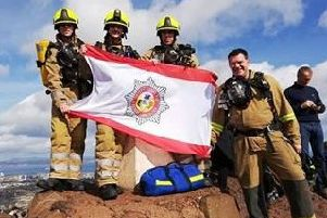 Volunteers from Scottish Charity International Fire And Rescue Association were undertaking a sponsored climb of Arthur's Seat when they were asked to assist a Tourist who had taken unwell. Picture: Contributed