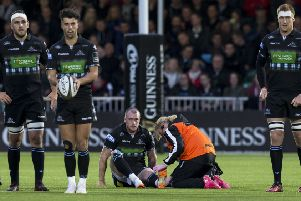 Glasgow Warriors' Stuart Hogg is treated on the pitch during the 25-10 win over Munster. Picture: SNS Group