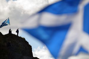 AUOB March for Independence''A couple of members of the march climbed up Arthurs Seat to watch the demonstration enter into Holyrood Park