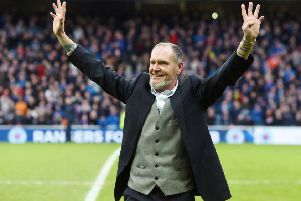 Paul Gascoigne greets Rangers fans after making a half time appearance at a game last season. Picture: SNS Group