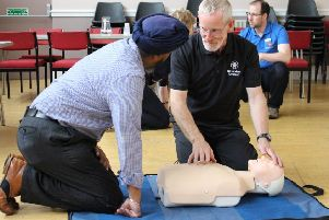 A St John Scotland volunteer demonstates CPR.