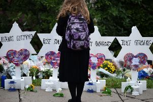 A woman stands at a memorial outside the Tree of Life synagogue after Saturday's mass shooting. Picture: AFP/Getty