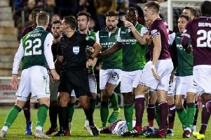 Tempers flared following the challenge by Hibs' Florian Kamberi on Hearts' Oliver Bozanic. Picture: Craig Williamson/SNS