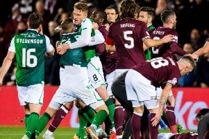 Players had to be separated during a heated confrontation in the Edinburgh derby. Picture: SNS
