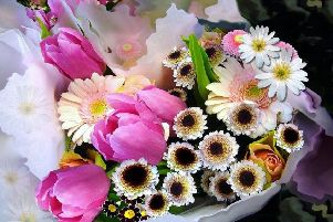 Susan exited Dundee with amassive bouquet of flowers ' which brought its own set of complications