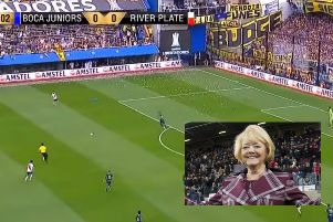 Main picture: The banner displayed at La Bombonera. Inset, the totally unrelated Ann Budge, owner of Hearts