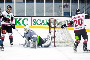 Racers attack the Solway netminder during a game which had ten goals . Picture: Ian Coyle