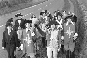 The Bay City Rollers walked from the GPO in Edinburgh to  Nazareth House in Lasswade to deliver Christmas presents to the children's home in December 1967. Seen in picture, manager Tam Paton (left, with moustache) Alan Longmuir and Derek Longmuir (at front).