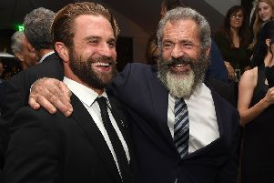Milo Gibson with dad Mel. Picture: Getty