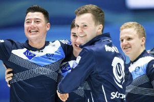 From the left: Scotland's Hammy McMillan, Bruce Mouat, Grant Hardie, and Bobby Lammie celebrate their victory. AP Photo/Raul Mee