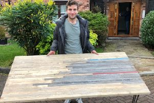 Callum Skinner with the table made from the old velodrome. Picture: Twitter