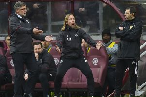 Craig Levein and Austin MacPhee appeal to fourth official Alan Muir. Picture: SNS
