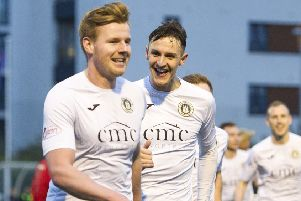 Blair Henderson, left, celebrates with Liam Henderson after scoring the first goal. Pics: Ian Rutherfords