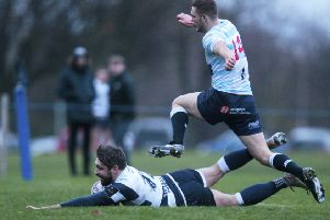 Craig Robertson of Heriot's goes over for the final try
