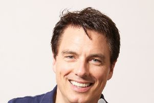 John Barrowman returns to I'm a Celebrity with sprained ankle