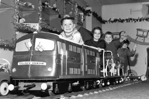 Children play on the model of the Golden Arrow engine in Jenners, Edinburgh, November 1965.