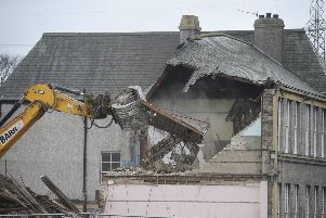 St John's Primary School on Duddingston Road is demolished by a digger. Picture: Greg Macvean