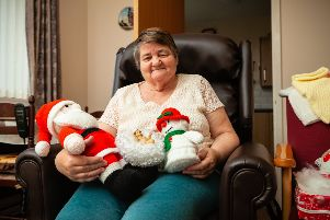 Irene Bishop, who lives at Bield's Whitehill Lodge in Dalkeith, has completed over 15 intricately designed knits, including penguins, logs, snowmen and Santa Clauses.