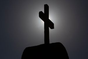 Picture of a cross taken in Punta de Tralca, west of Santiago, on July 30, 2018 as Chile's Episcopal Conference holds an extraordinary meeting to analyze the roots of the current crisis that the Catholic Church is experiencing in the country, burdened by the scandals of sexual abuse and cover-up, and how to overcome it. - Chile is investigating more than 150 members of the country's embattled Catholic Church -- both clergymen and lay people -- for perpetrating or concealing the sexual abuse of children and adults, prosecutors said last week. (Photo by CLAUDIO REYES / AFP)        (Photo credit should read CLAUDIO REYES/AFP/Getty Images)