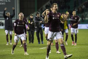 Hearts captain Christophe Berra celebrates at Easter Road as the Jambos picked up a vital victory