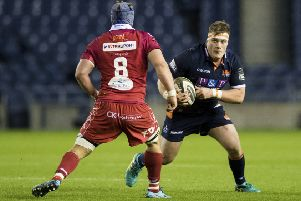 Murray McCallum takes on Scarlets' Will Boyde during a PRO14 clash at Murrayfield in November. Picture: SNS Group