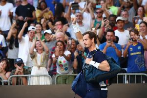 Andy Murray waves as he walks onto court prior to his first round match against Roberto Bautista Agut at Melbourne Park. Picture: Cameron Spencer/Getty Images