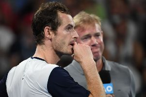 Andy Murray casts his eyes to the screen as a video montage begins following his first round exit at the Australian Open. Picture: AFP