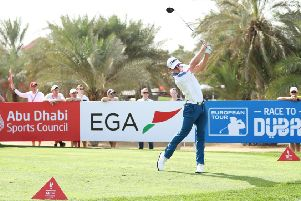 Grant Forrest of Scotland plays his shot from the ninth tee during his third round at the Abu Dhabi Golf Club