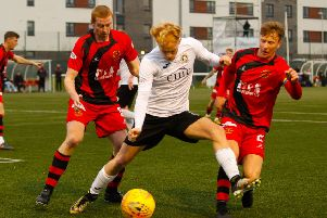 Scott Shepherd of Edinburgh City is surrounded by Annan Athletic players