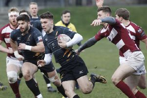 Ben Robbins for Currie, makes a break against Watsonians at Myreside