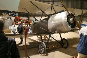 Members of the Aviation Preservation Society of Scortland work on the Sopwith biplane