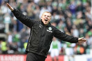 Hibernian manager Neil Lennon celebrates in front of the Rangers fans after his team scored a late equalising goal at Easter Road