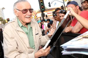 Comic book icon Stan Lee signs autographs for fans''Pic: Jesse Grant/Getty Images for Disney