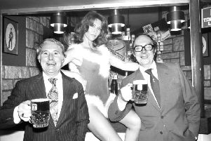 Eric Morecambe and (left) Ernie Wise enjoy a pint of Tennent's lager with Erica, one of the 'can models' when they visited the Heriot brewery at Roseburn, Edinburgh, in 1978.