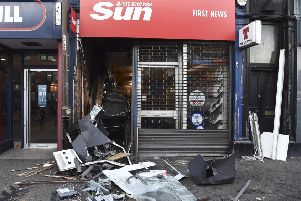 A newsagents on Gorgie Road was ram raided by a digger in the early hoours of the morning.  The thieves had targeted the ATM. Pic: Lisa Ferguson