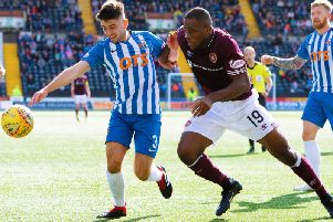 Uche Ikpeazu challenges Greg Taylor in the last meeting between the two sides at Rugby Park, which Hearts won 1-0.